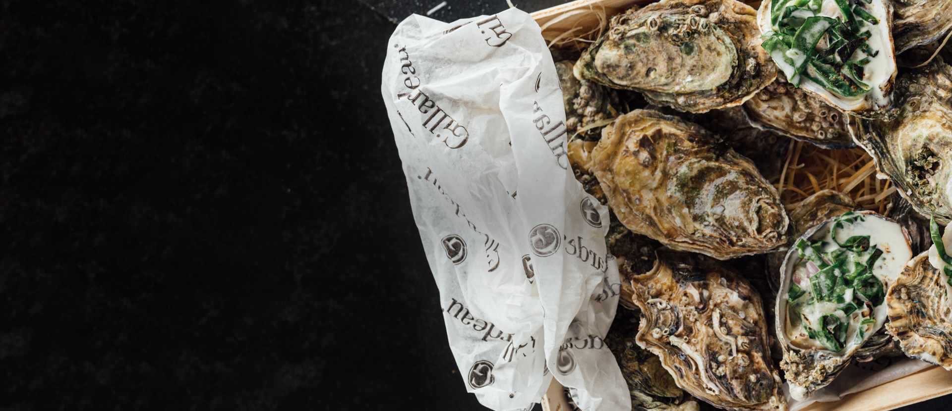 Warm oyster with creamy spinach and parmesan